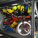 Bikes and gear squeezed into the short bay on the bus.