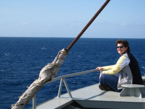 Becky sitting on the bow of the Hanjin Brussels