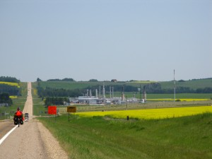Approaching a processing plant, with flare stacks